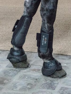 Side view of a pair of Husk 3D shield air no spin over reach boots